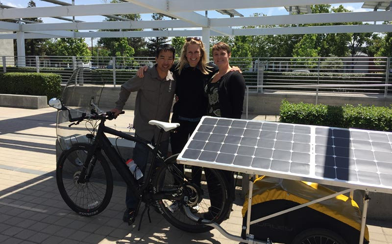 Marissa Muller and her solar bike with Kat and Kingsley from SunPower