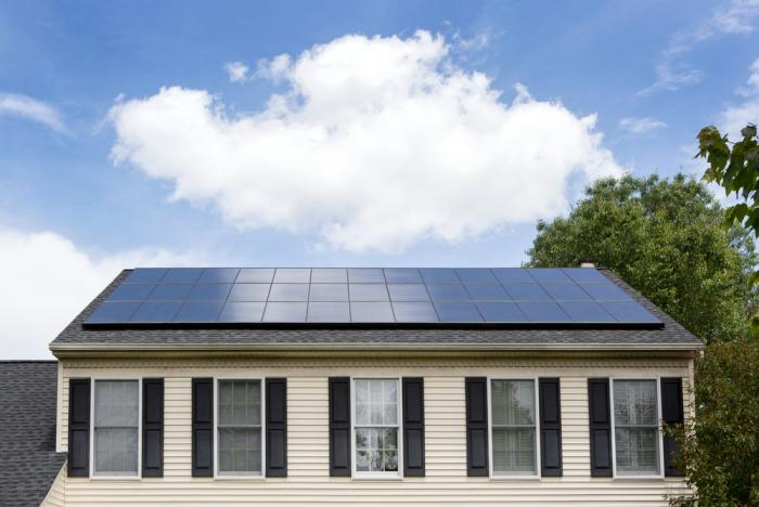A solar home that's making energy despite a few clouds above.