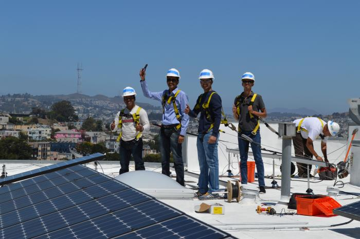 SunPower interns volunteer with GRID to install rooftop solar panels.